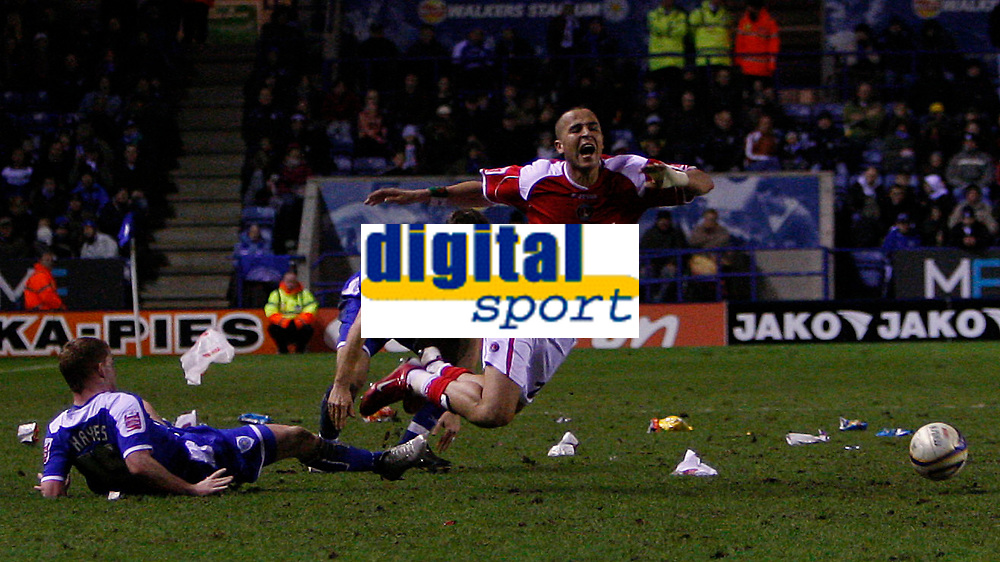 Photo: Steve Bond/Sportsbeat Images.<br /> Leicester City v Charlton Athletic. Coca Cola Championship. 29/12/2007. Jonathan Hayes (L) brings down Yassin Moutaoukil (R) as the rubbish blows around the pitch