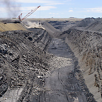 A strip mine pit is exposed as a drag line digs for coal at the Navajo Mine near Farmington Wednesday.