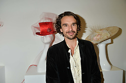 Actor EDWARD AKROUT at a private view and auction of millinery organised by author, philanthropist and hat collector Eva Lanska in aid of Women for Women International held at Pace, Burlington Gardens, London on 10th June 2015.