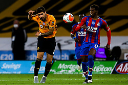 Ruben Neves of Wolverhampton Wanderers passes the past Wilfried Zaha of Crystal Palace - Mandatory by-line: Robbie Stephenson/JMP - 20/07/2020 - FOOTBALL - Molineux - Wolverhampton, England - Wolverhampton Wanderers v Crystal Palace - Premier League