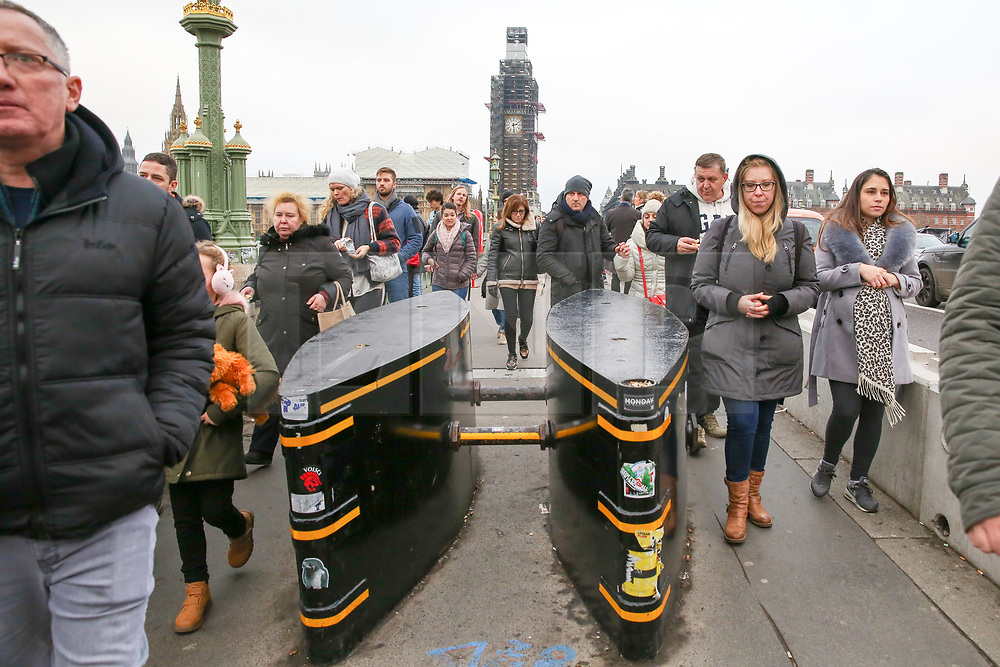 © Licensed to London News Pictures. 30/12/2018. London, UK. People pass the security barriers on Westminster Bridge in front of Big Ben in Westminster, ahead of New Year celebrations. Photo credit: Dinendra Haria/LNP