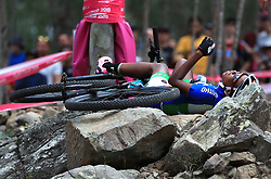 Lesotho's Likeleli Masitise falls off her bike in the Women's Cross-Country at the Nerang Mountain Bike Trails during day eight of the 2018 Commonwealth Games in the Gold Coast, Australia.