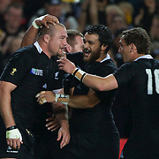 Tony Woodcock, New Zealand, (left) is congratulated by team mates Piri Weepu and Aaron Cruden, (right) after scoring New Zealand's only try of the match during the New Zealand V France Final at the IRB Rugby World Cup tournament, Eden Park, Auckland, New Zealand. 23rd October 2011. Photo Tim Clayton...