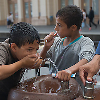 Illegal migrant boys brush their teeth as their family waits to board a train in hopes to leave for Germany at the main railway station Keleti in Budapest, Hungary on September 03, 2015. ATTILA VOLGYI