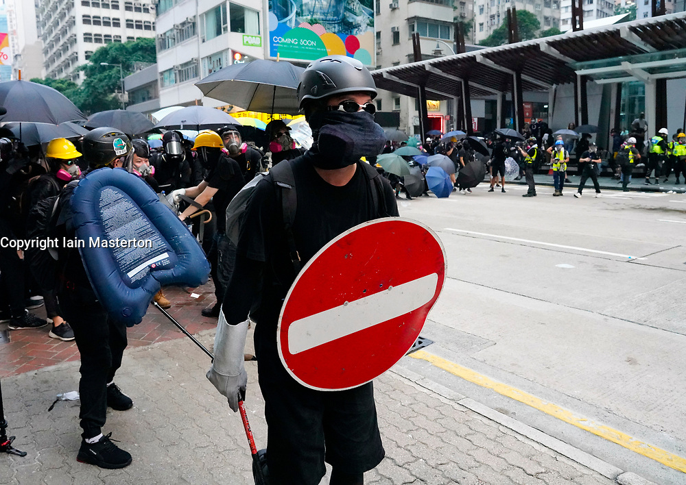 Hong Kong. 29 September, 2019. Illegal march by thousands of pro-democracy supporters from Causeway Bay to Government offices at Admiralty. Police unsuccessfully tried to stop march at start with teargas fired and scuffles. March marked the 5th anniversary of the start of the Umbrella Movement. Pic. Protestors use improvised homemade shields to confront police.