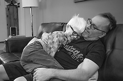 Bryan Hoben shares a cuddle with his son Forest while social distancing at home during the coronavirus pandemic in the Hudson Valley, New York. Forest and Lotus Hoben, ages 10 and 6, were adopted from China and have albinism, a rare group of genetic disorders that cause the skin, hair, or eyes to have little or no color. Albinism is also associated with vision problems. According to the National Organization for Albinism and Hypopigmentation, about 1 in 18,000 to 20,000 people in the United States have a form of albinism.