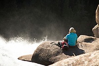 Young woman hiking in Yosemite National Park, CA.