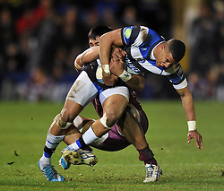 Anthony Watson (Bath) is tackled in possession - Photo mandatory by-line: Patrick Khachfe/JMP - Tel: Mobile: 07966 386802 16/01/2014 - SPORT - RUGBY UNION -  The Recreation Ground, Bath - Bath Rugby v Bordeaux-Begles - Amlin Challenge Cup.