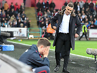 Football - 2017 / 2018 Premier League - Swansea City vs. Southampton<br /> <br /> Swansea City manager Carlos Carvalhal looks down & a ball boy holds his head in the foreground as Swansea head for defeat, at Liberty Stadium.<br /> <br /> COLORSPORT/WINSTON BYNORTH