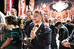March 4, 2018 - Hollywood, California, U.S. - GUILLERMO DEL TORO (center) and Paul Denham Austerberry accept the Oscar for best motion picture of the year for work on The Shape of Water during the live ABC Telecast of The 90th Oscars at the Dolby Theatre in Hollywood. (Credit Image: ? Todd Wawrychuk/AMPAS via ZUMA Wire/ZUMAPRESS.com)