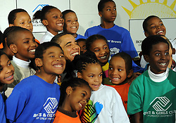 US President Barack Obama poses with elementary aged children at a Boys and Girls Club in Washington DC, USA on December 21, 2009. After reading, the President passed out cookies. Photo by Roger L. Wollenberg/ABACAPRESS.COM  | 213840_004 Washington