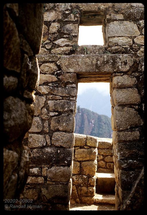 Two portal and skylight in eastern urban sector frame lower part of Huayna Picchu; Machu Picchu. Peru