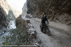 Sean Lichter riding through a narrow canyon on Day-7 of our Himalayan Heroes adventure riding from Tatopani to Pokhara, Nepal. Monday, November 12, 2018. Photography ©2018 Michael Lichter.