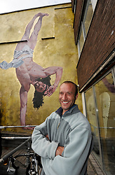 © Licensed to London News Pictures. 11/06/2013. Bristol, UK.  Artist Cosmo Sarson with his mural titled Jesus Breakdancing on the wall by The Canteen bar on Stokes Croft in Bristol.  Cosmo won a competition sponsored by The Canteen to paint the mural, which was made with 1kg of gold glitter.  The mural was inspired by a breakdancing performance at the Vatican for Pope John Paul II.  11 June 2013.<br /> Photo credit : Simon Chapman/LNP