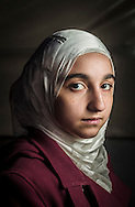 Sham, age 16, from Homs, a Syrian refugee girl from the Free Syria school, during an art class at a local tea garden.