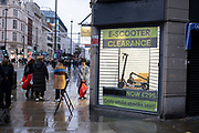E-scooter clearance sale as Londoners await the imminent second coronavirus lockdown it's business as usual in the West End with large numbers of people, some wearing face masks and some not, brave the rain on Oxford Street to go shopping on what will be the last weekend before a month-long total lockdown in the UK on 1st November 2020 in London, United Kingdom. The three tier system in the UK has not worked sufficiently, to suppress the virus, and there have have been calls by politicians for a 'circuit breaker' complete lockdown to be announced to help the growing spread of the Covid-19.