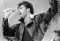 George Michael on stage at Wembley Stadium for the Wham! sell-out farewell concert.