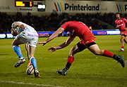 Sale Sharks scrum-half Will Cliff touches down for a try chased by Saracens full-back Matt Gallagher during a Premiership Rugby Cup Semi Final won by Sale 28-7, Friday, Feb. 7, 2020, in Eccles, United Kingdom. (Steve Flynn/Image of Sport)