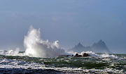 Waves crash on rocks in The Glen, Ballinskelligs, County Kerry during a big Atlantic Swell with the famous Skelligs Rocks in the background.<br /> Picture by Don MacMonagle - macmonagle.com