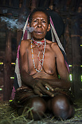Dani tribe woman inside<br /> Budaya village<br /> Suroba<br /> Trikora Mountains<br /> West Papua<br /> Indonesia<br /> Inside hut