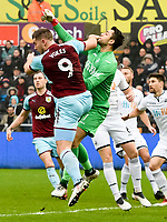 Football - 2017 / 2018 Premier League - Swansea City vs. Burnley<br /> <br /> Lukasz Fabianski of Swansea City punches the ball clear challenged by Sam Vokes of Burnley, at The Liberty Stadium.<br /> <br /> COLORSPORT/WINSTON BYNORTH