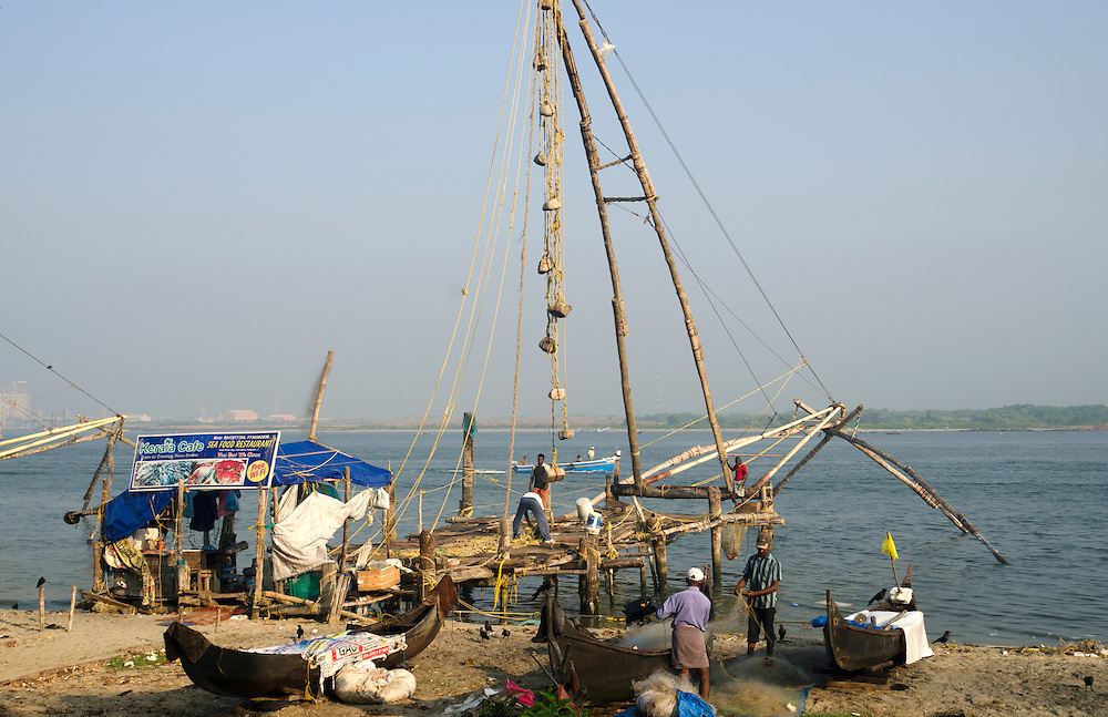 Men work on Chinese Fishing Nets in Fort Cochin, Kerala, South India