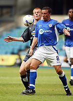 Photo: Chris Ratcliffe.<br />Millwall v Crystal Palace. Pre Season Friendly. 29/07/2006.<br />Ben Watson (L) of Crystal Palace clashes with Derek McInnes of Millwall.