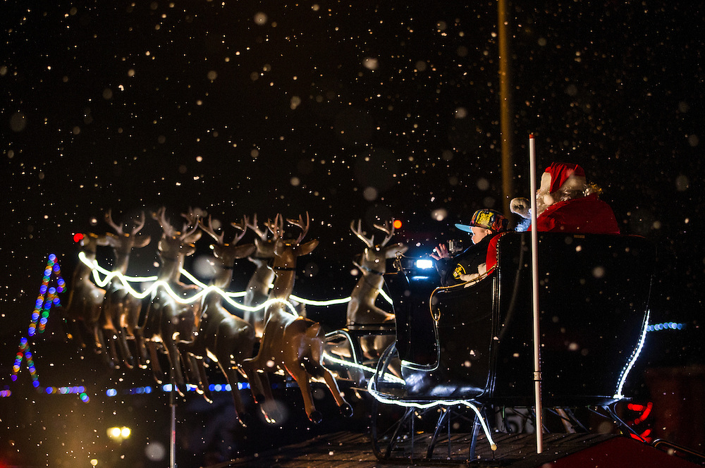 Evan Leversage, who is terminally ill with brain cancer, rides off in the Santa Claus in a float during a Christmas parade in St. George, Ontario, Canada October 24, 2015.  Evan Leversage, is a seven-year-old boy who has been living with inoperable brain cancer since he was two years old. His family has organized a Christmas celebration in early October complete with a full parade, in case Evan does not live to celebrate his last Christmas day on the traditional date of December 25, according to local media.    REUTERS/Mark Blinch