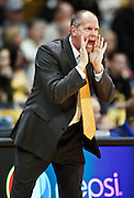 SHOT 1/21/12 5:15:04 PM - Colorado head basketball coach Tad Boyle coaches against Arizona during their PAC 12 regular season men's basketball game at the Coors Events Center in Boulder, Co. Colorado won the game 64-63..(Photo by Marc Piscotty / © 2012)
