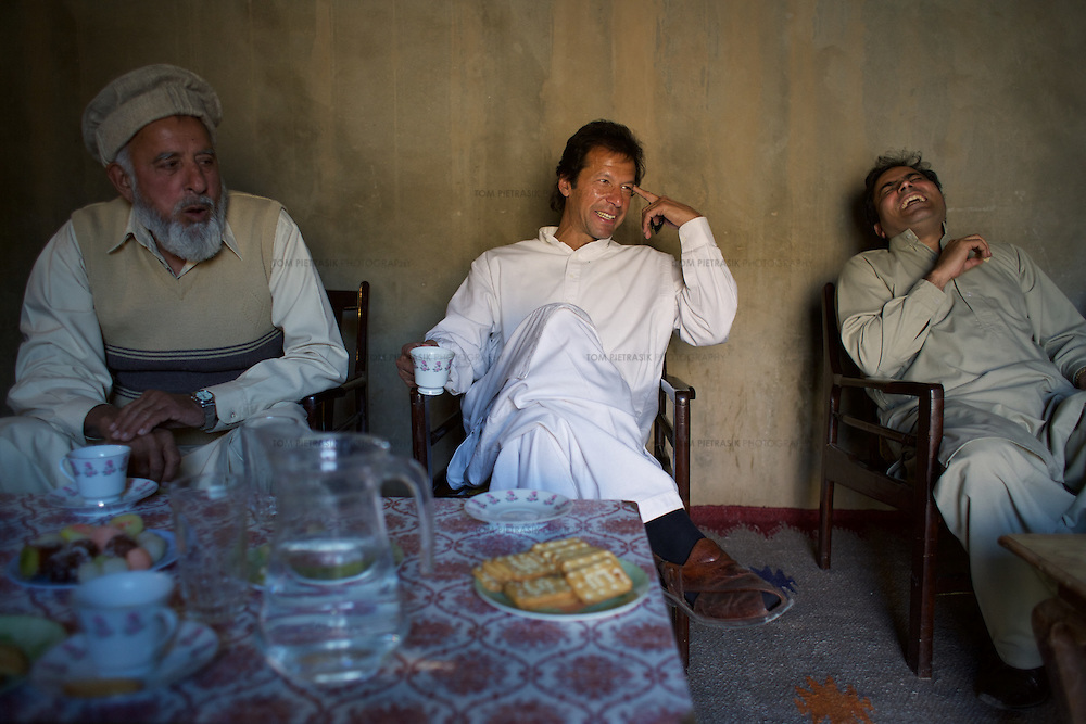 Imran Khan and members of his polical party Tehrik-e-insaaf meet Khan's constituents in the village of Moch. Imran Khan became a Member of the Pakistani Parliament for Mianwali, Panjab, in the October 2002 elections.<br /> <br /> Cricketer Imran Khan made his Test debut against England in 1971. He became captain of the Pakistan team in 1982 and lead them to World Cup victory in 1992 after which he retired.<br /> <br /> Imran Khan established the Tehrik-e-insaaf (or Moverment for Justice) in 1996. Through Tehrik-e-insaaf, Khan has demanded that the Pakistan government make institutional reforms to address corruption and end the present dictatorship. Khan would like a more equitable distribution of resources in Pakistan, the granting key civil liberties and an increas in public service spending. He is particularly scathing of the relationship between President Musharraf and US President Bush.<br /> <br /> Photo: Tom Pietrasik<br /> Panjab, Pakistan<br /> 28th January 2006