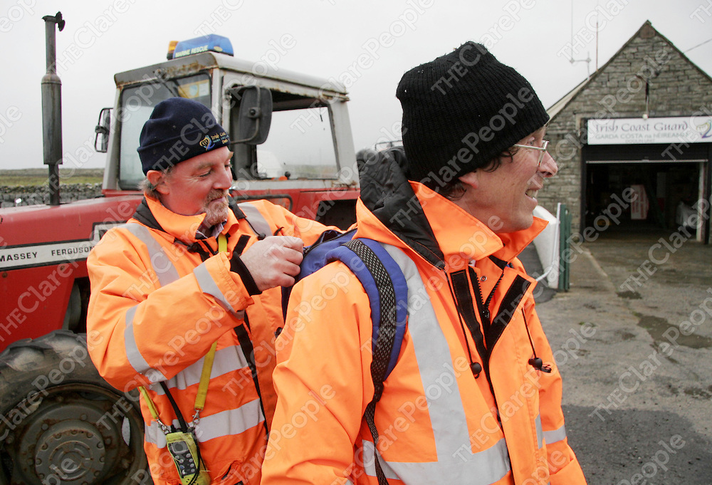 Doolin Coast Guard volunteer Kevin Griffin checks that he and search mate Richie Jones have all they need to begin their shoreline search for two missing men in Doolin during the week, as bad weather prevented any sea search to get underway.<br /> <br /> Photograph by Yvonne Vaughan.