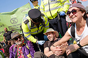 Extinction Rebellion climate change protest on 19th April 2019 in London, United Kingdom. Protesters occupy major London traffic arteries to call on the governemnt to act on the climate and environmental disaster. Extinction Rebellion is a socio-political movement which intends to utilise nonviolent resistance to avert climate breakdown, halt biodiversity loss, and minimise the risk of human extinction and ecological collapse.