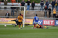 Matt Tubbs (9) of Portsmouth shoots and scores his teams 1st goal. Skybet football league two match, Newport county v Portsmouth at Rodney Parade in Newport, South Wales  on Saturday 17th October 2015.<br /> pic by  Andrew Orchard, Andrew Orchard sports photography.