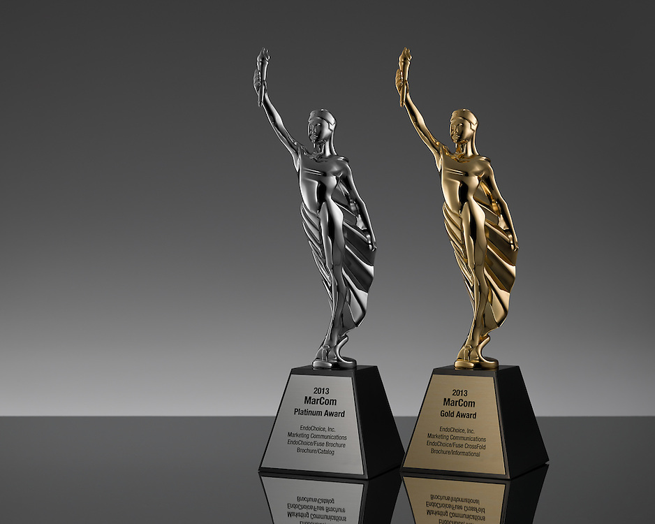 Two MarCom Award statues, Platinum & Gold with plates engraved with info regarding the awards being given to EndoChoice, Inc. for marketing items featuring medical product photography by Joshua Geigerof GeigerFoto.