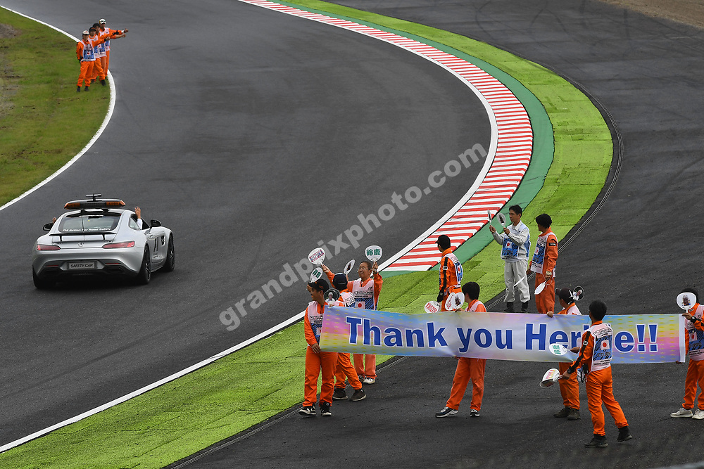 Local marshals thank FIA official Herbie Blash in safety car before the 2016 Japanese Grand Prix in Suzuka. Photo: Grand Prix Photo