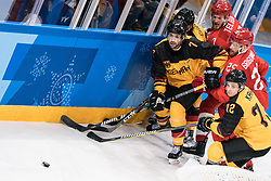 PYEONGCHANG, Feb. 25, 2018  Germany's Daryl Boyle (1st L) vies for the puck during the men's ice hockey final against Olympic athletes from Russia at Gangneung Hockey Centre, in Gangneung, South Korea, Feb. 25, 2018. Germany lost the final 3-4 and took the second place. (Credit Image: © Wu Zhuang/Xinhua via ZUMA Wire)