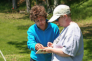 Dr. Jean Hudson (left) of UW-Milwaukee working on the recovery and preservation of the Silver Beach Elk skeleton rcovered from Middle Eau Claire Lake in Bayfield County, Wisconsin