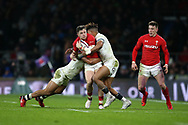 Steff Evans of Wales is stopped by England's Jonathan Joseph and Anthony Watson (r). England v Wales, NatWest 6 nations 2018 championship match at Twickenham Stadium in Middlesex, England on Saturday 10th February 2018.<br /> pic by Andrew Orchard, Andrew Orchard sports photography