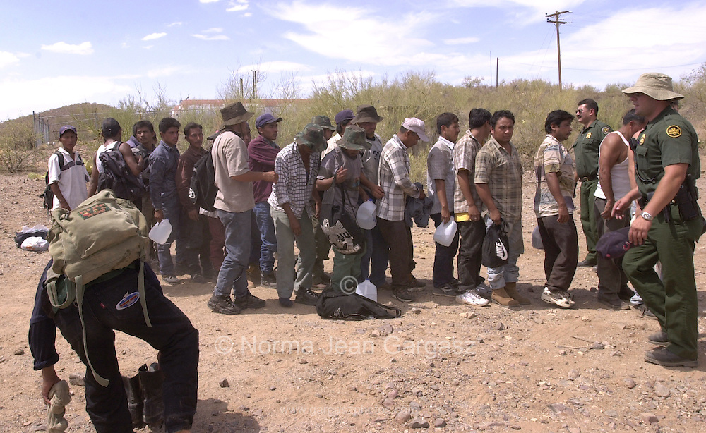 While groups of men mostly between the ages of 18 and 25, such as this group apprehended by the Border Patrol on the Tohono O'odham Reservation, typifies the profile of illegal entrants into the U.S. from Mexico, women and children often cross through the brutal heat of the West Desert to join their husbands and fathers.  A 16-year-old male, Ezequias Emeeino from Chaipas, made the trip with this group with his cousin.  (PHOTO: NORMA JEAN GARGASZ)