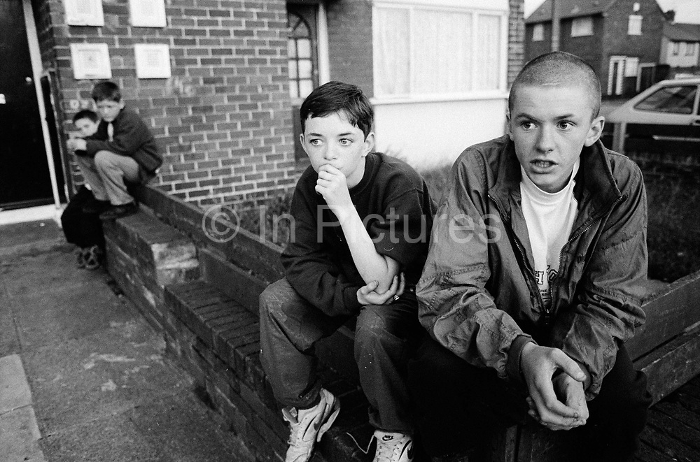 Two boys while away their day on the Northwood Estate Kirkby, Merseyside a notoriously run down inner city area
