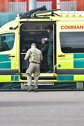 © Licensed to London News Pictures. 02/04/2020.  London UK: London Ambulance service staff meeting with army personnel at the Nightingale hospital in east London  , Photo credit: Steve Poston/LNP