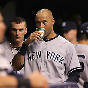 New York Yankees shortstop Derek Jeter (2) drinks his Gatorade in the dugout  during a major league baseball game between the New York Yankees and the Tampa Bay Rays at Tropicana Field on Thursday, Sept. 17, 2014 in St. Petersburg, Florida. The Yankees won the game 3-2 and this was Jeter's last game against Tampa Bay. (AP Photo/Alex Menendez)