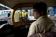 Shafiq Syed, 34, is thoughtful while driving his rickshaw along the busy road of Bangalore city centre, Karnataka, India. Shaifq has been the main character of the Cannes' Camera D'Or 1988 winner Salaam Bombay, but after the movie he failed to become a star, fell back into poverty and lived on the streets for years before he became a rickshaw (tuk-tuk) driver in his home city of Bangalore, Karnataka State, India.