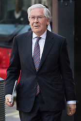 © licensed to London News Pictures.  25/06/2013. London, UK. Governor of the Bank of England MERVYN KING walking to Portcullis House for a Treasury Select Committee for the last time. King is to leave his office as the Governor of the Bank of England on 30 June 2013, to be replaced by Mark Carney. Photo credit: Tolga Akmen/LNP