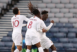 Portugal's Eder (right) celebrates scoring his side's second goal of the game during the International Friendly match at Hampden Park, Glasgow.