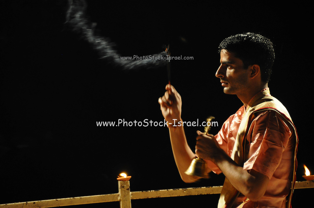 Man performs the nightly Hindu Puja Rituals in Varanasi, Uttar Pradesh, India