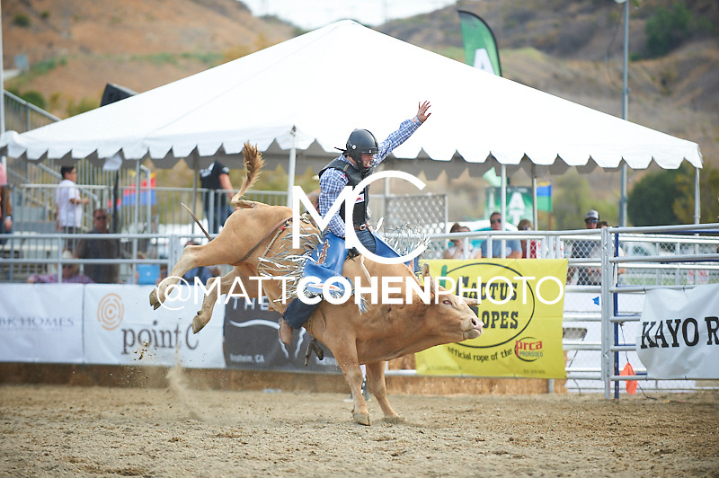 Bull rider Cody Teel of Kountze, TX rides 874 Igor at the Rancho Mission Viejo Rodeo in San Juan Capistrano, CA.  <br /> <br /> <br /> UNEDITED LOW-RES PREVIEW<br /> <br /> <br /> File shown may be an unedited low resolution version used as a proof only. All prints are 100% guaranteed for quality. Sizes 8x10+ come with a version for personal social media. I am currently not selling downloads for commercial/brand use.