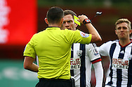 Craig Gardner of West Bromwich Albion receives a yellow card from referee Michael Oliver. Barclays Premier League match, Stoke city v West Bromwich Albion at the Britannia stadium in Stoke on Trent, Staffs on Saturday 29th August 2015.<br /> pic by Chris Stading, Andrew Orchard sports photography.