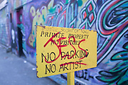 Sign warns people and artists to stay away from their private property. Brick Lane, London, UK. This lane is very well known for street art and with graffiti artists as a location for their work. The owners however, have other ideas.