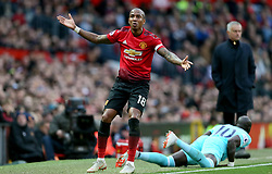 Manchester United's Ashley Young gestures to the Referee